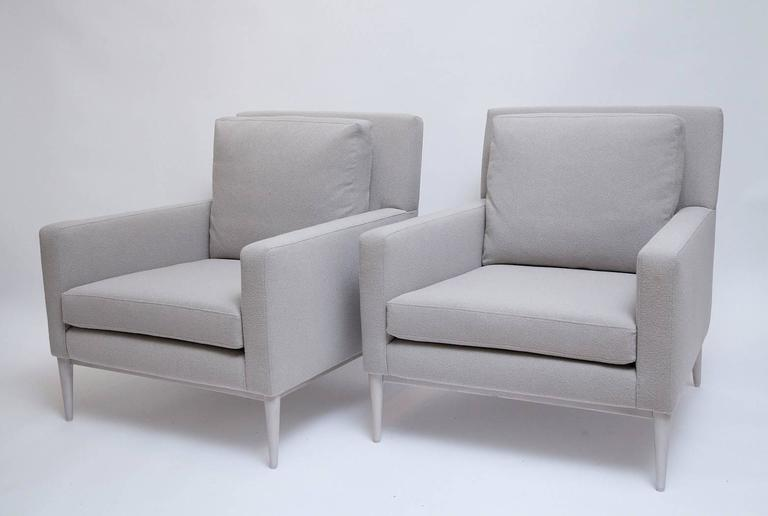 Gorgeous and iconic Mid-Century pair of fully restored lounge chairs by Paul McCobb for Directional with bleached walnut legs and all new foam with down wrapped back cushions, upholstered in a pale greige Beacon Hill wool blend, super-fine bouclé.
