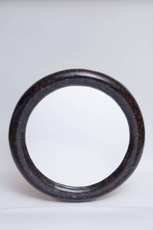 Rich black and brown bull-nosed mirror of resin and cork tree inlay by Enrique Garces, Colombia circa 1980. Professionally restored.