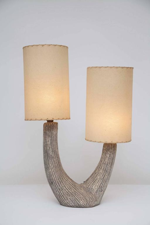 Cream and grey textured ceramic lamp by Kelby, with original whip-stitched paper shades, circa 1950.