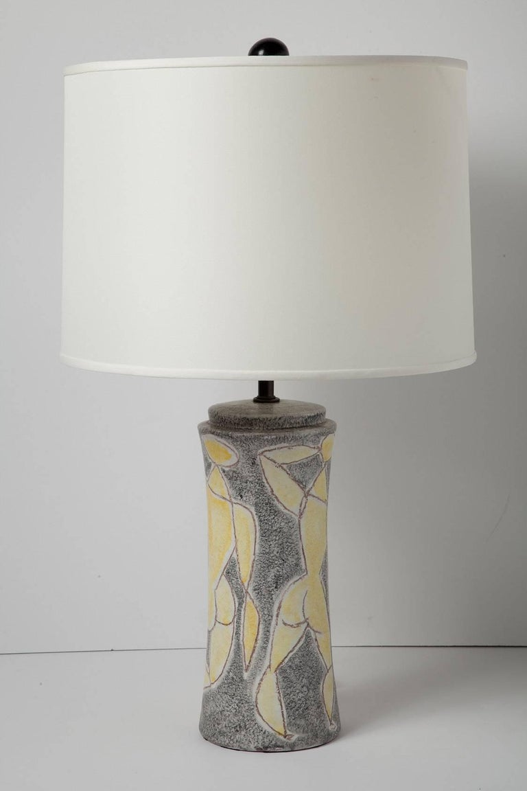 Signed 1950s Italian ceramic lamp by Marcello Fantoni, featuring captivating crayon-style figural drawings. Signed on verso. (Lamp only. Shade, harp and finial not included.) Height measurement is 17.5