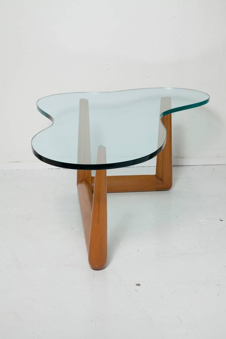 Timeless, Classic Mid-Century Modern biomorphic coffee table By T.H. Robsjohn-Gibbings For Widdicomb with gorgeous original green glass top.