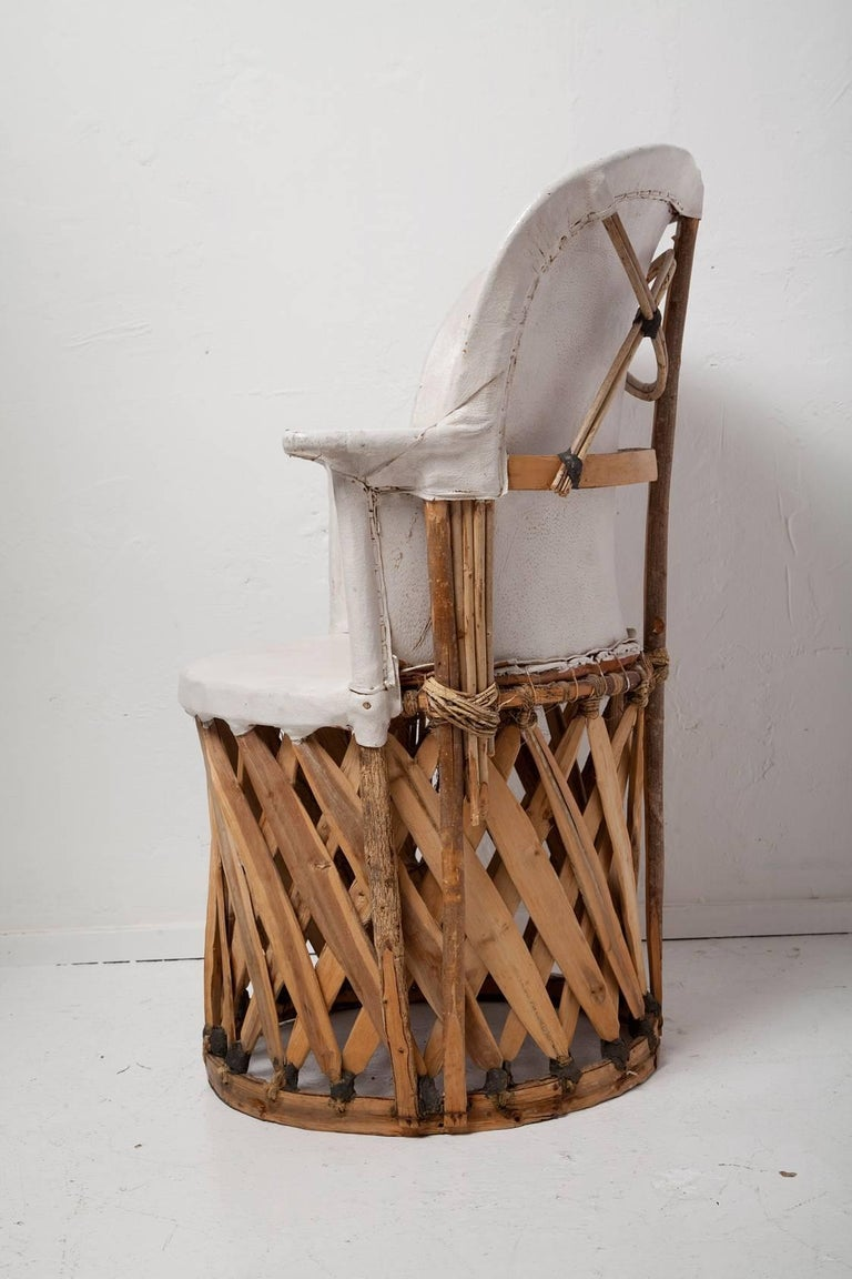 Swoon-worthy pair of vintage Mexican equipale chairs in white pigskin leather and hand-wrapped cedar are loaded with unique and stylish details (and an enviable patina).