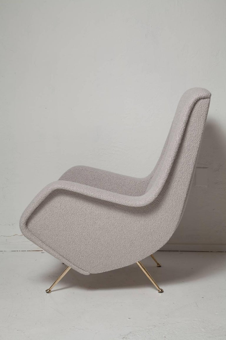 Sexy pair of fully restored Zanuso style 1950s Italian lounge chairs, impeccably upholstered in a soft pearl grey mohair blend bouclé, with original brass legs, brilliantly polished.
