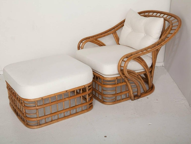 This classic and curvaceous fully restored 1970s bamboo lounge chair and ottoman, newly upholstered in a soft all-weather oxford cloth, looks as good from the back as it does from the front. Ottoman measures H 14 in. x W 24 in. x D 24 in.