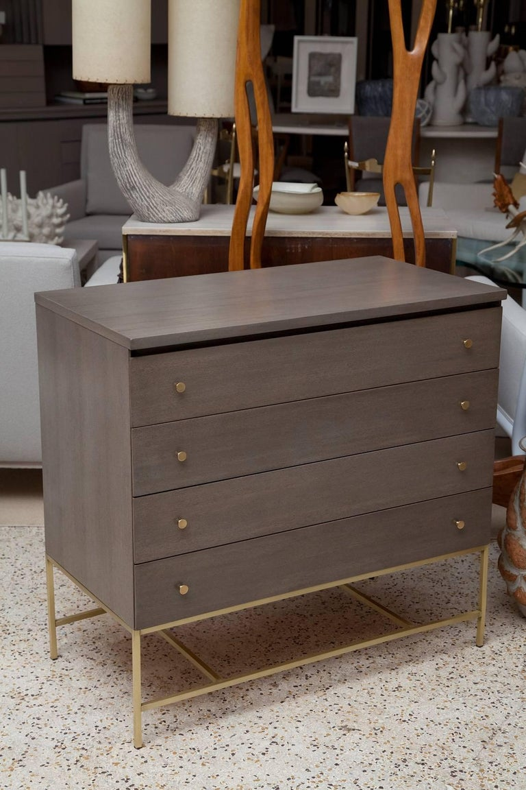 I love olive, and you will too when you see this gorgeous custom grey-green mahogany bachelor chest with solid brass hardware, part of the Irwin collection, designed by Paul McCobb for Calvin. Immaculately restored.