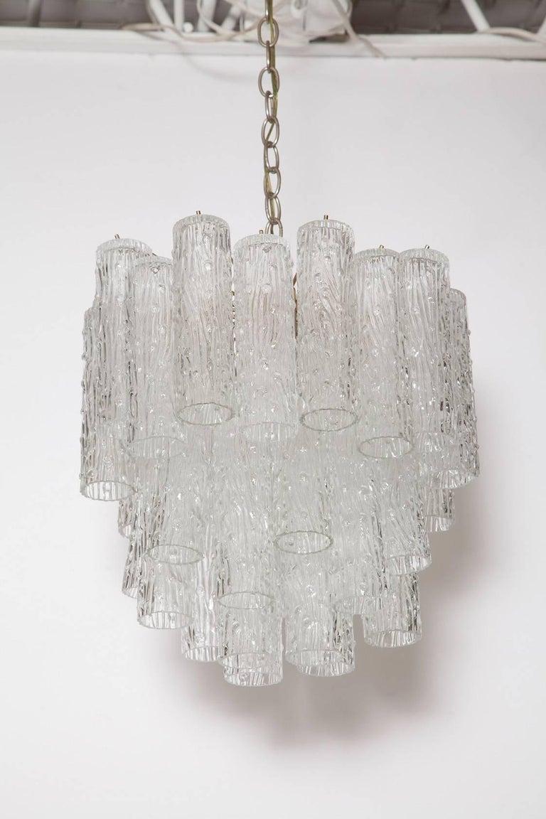 Nicely sized handblown Murano glass tubular tronchi chandelier with chrome frame by Venini, circa 1969.