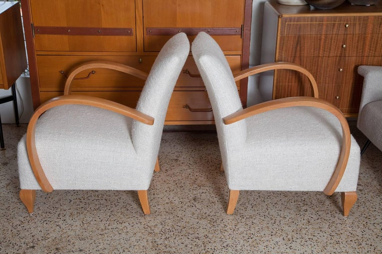Stylish pair of fully restored 1940s French Deco style lounge chairs, richly upholstered in a handwoven raw silk tweed.