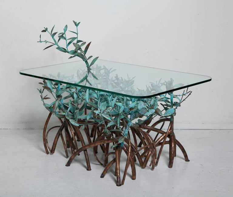If you frequent South Florida or the Caribbean, you'll recognize the ubiquitous mangrove trees that serve as inspiration for this wonderful hand-wrought and patinated copper coffee table by Garland Faulkner, circa 1960. The tabletop measures 20.5