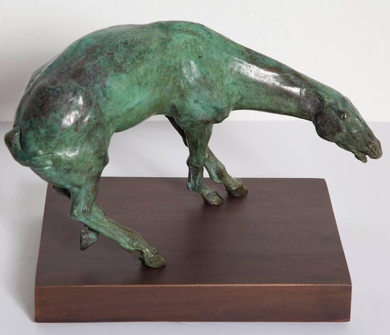 Fine bronze equine sculpture by Gary Weisman (American, b.1952) on wood plinth. Among the world's finest figural sculptures, his pieces combine the rigor of classical Greco-Roman and Italian Renaissance works with twisted, emotive forms. Plinth