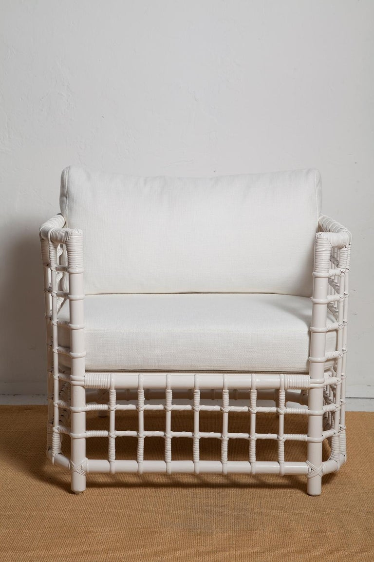 A fresh summery take on Le Corbusier's iconic LC2 chair, these 1970's woven bamboo chairs have been given a new coat of white paint, all new foam cushions (backs are down-wrapped for added comfort), and simple textured cotton blend upholstery.