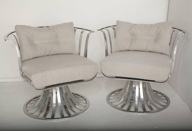 Professionally polished and lacquer sealed, and newly upholstered in a cream-flecked greige all-weather bouclé, these 1960s aluminum chairs by Russell Woodard were designed for outdoors, but we think they're substantial (and glamorous) enough for