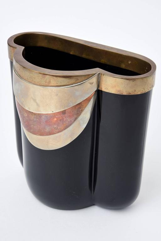 This stunning and never seen before rare vintage Italian Antonio Pavia Italian Murano vase is like a piece of jewelry or sculpture. The drape like form of the mixed metals of copper, brass, nickel are reminiscent of the influences of Egyptian