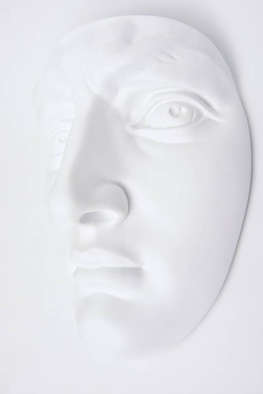 This vintage 1960s newly white painted resin and plaster of Paris face wall sculpture is from a company in Chicago. It is marked on the back. It makes an interesting decorative art wall sculpture. It has been restored.  PLEASE NOTE: THIS WILL BE ON