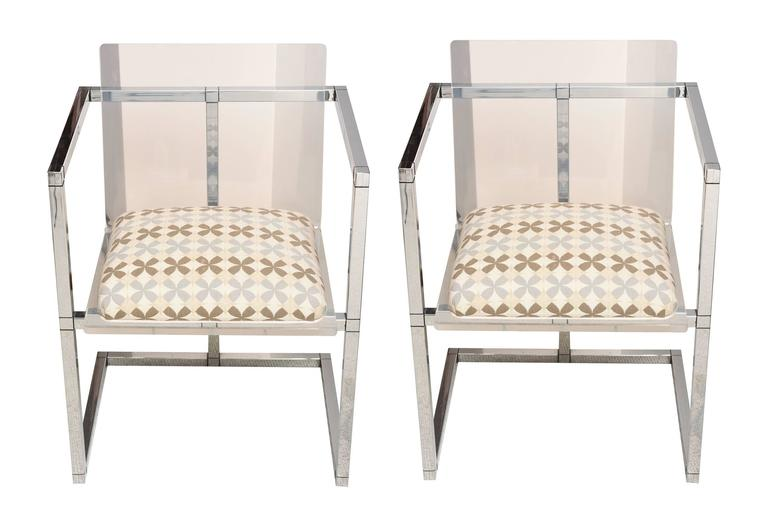These unusual square side chairs have high box arms with a slab of clear Lucite as the back. They have a great architectural look. Sold as a pair only! Please. They are tres chic!