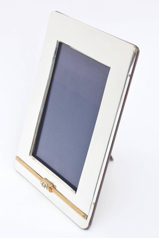 This lovely large Italian Gucci picture frame is simple and elegant. The 24-carat gold-plated bar on the bottom has all been redone as well as the silver plating. The GG's rest on the gold-plated bar. Fully restored as best as can be. The high gloss