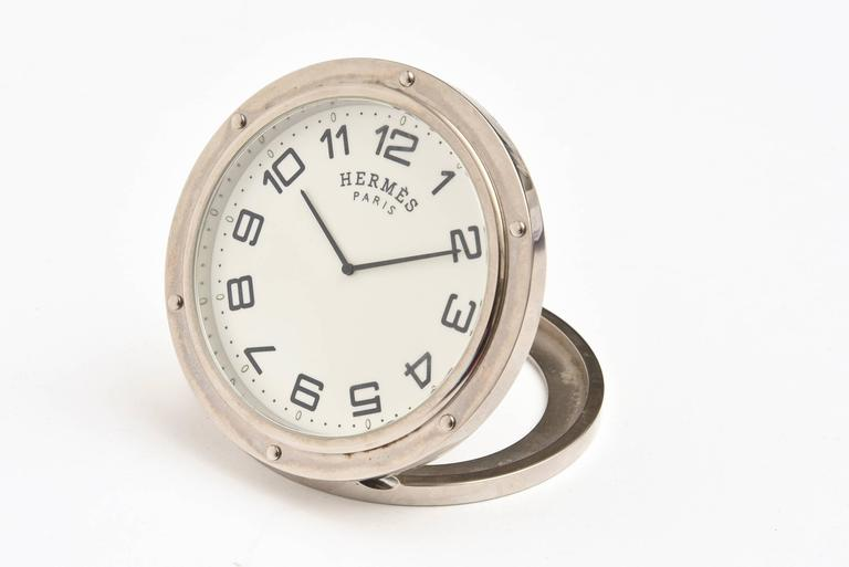 This now discontinued French Hermes travel or desk clock is ultra chic and always modern. It is all documented on the back. It makes for a great bedside clock, desk clock and or travel clock. It is not the alarm clock however. These came in two
