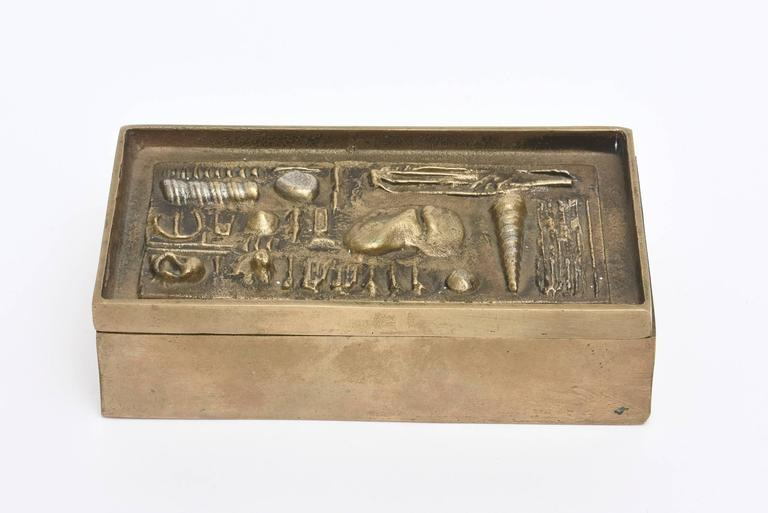 """This amazing bronze sculptural box by the noted Italian sculptor; Arnaldo Pomodoro is unique in many ways.  The bronze forms of textural objects on the top are at random. It is signed """"Il Sestante Pomodoro to Anni F.C.B.""""  This was"""