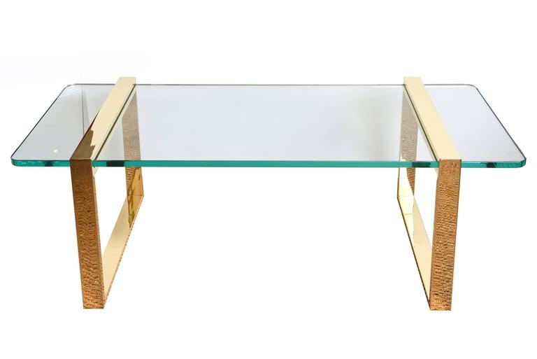 This modernist and Minimalist stunning Leon Rosen for Pace real 24-karat gold-plated cocktail table and or library table has two elegant squares that slide into the glass. They are attached and tightened underneath. This is a piece of sculpture, of