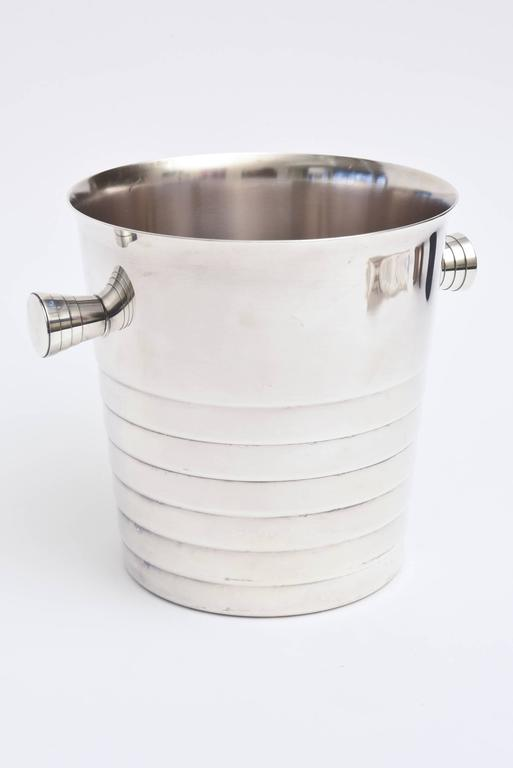 This Classic and timeless French Christofle champagne / ice bucket is silver plate. It is forever. The Classic lines incised make up an elegant and timeless sculptural form. Great barware!