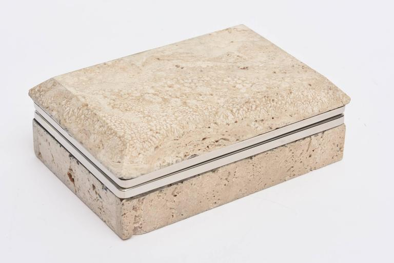 This vintage organic modern Italian travertine stone and nickel silver hinged box is a great desk accessory and or cocktail table. The metal has been polished. It is from the 1970s.The travertine has natural craters in it and on the front it looks