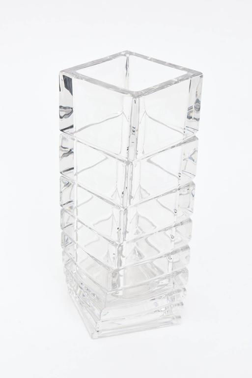 This shape and variance in this twisted and staggered Mid-Century Modern Rosenthal glass vase is usually seen in white porcelain rather than in clear glass. This is unusual now in the market. It is sculptural and architectural. Rosenthal from