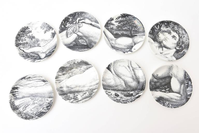 These lovely and interactive set of eight Piero Fornasetti porcelain Mid-Century Modern coasters / small plates are of the allegorical and biblical