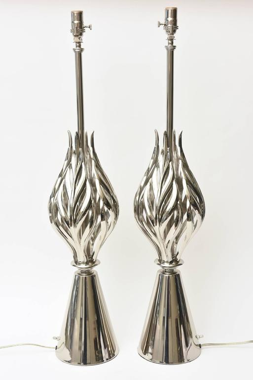 This pair of monumental restored Mid-Century Modern Rembrandt lamps have a great vibe of Hollywood Regency style. The abacus leaves that flare in elegant sculptural form add to the dimension. Their conical bases are of grace. They have been newly