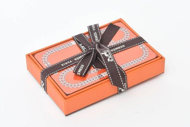 These hermetically sealed French Hermes playing cards have a geometric pattern. They are still sealed and wrapped up. Never used. These also make a great gift for the host or hostess.
