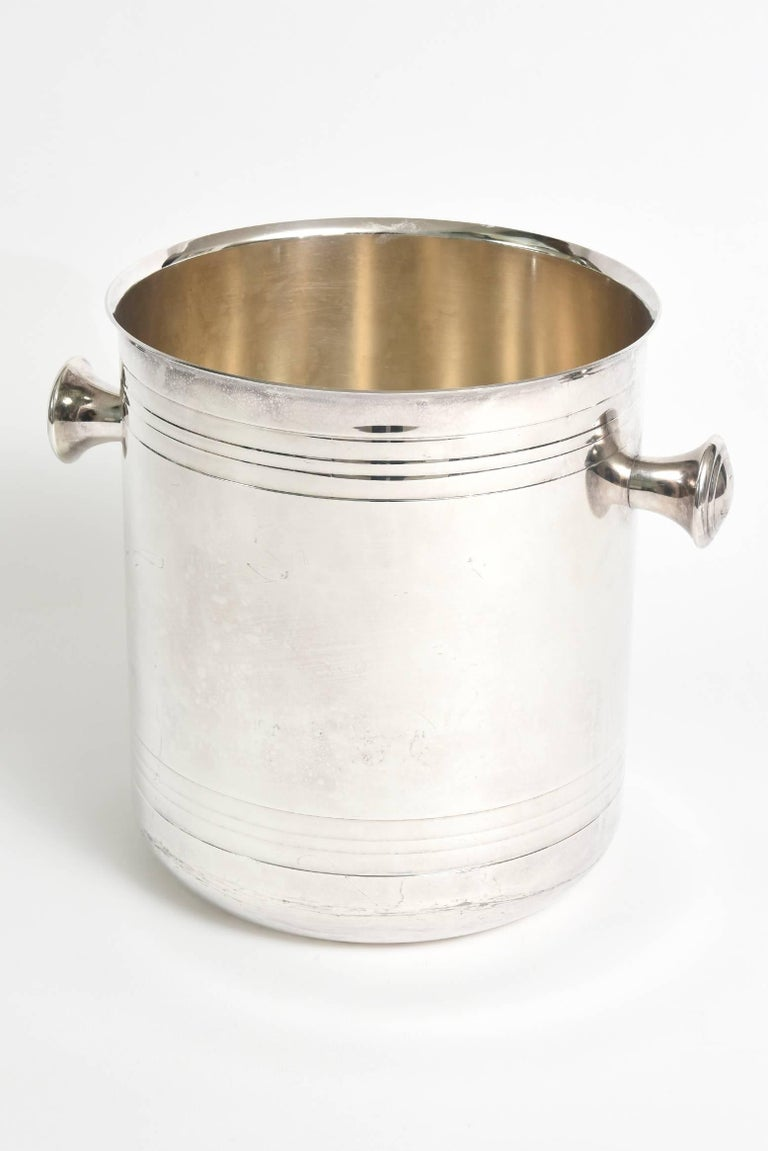 This lovely French hallmarked  Christofle champagne cooler  /ice bucket is silver-plate and from the 1980s. It is reminiscent of an art deco design with modernist influences. A great barware edition. It is hallmarked in 2 places.The diameter below