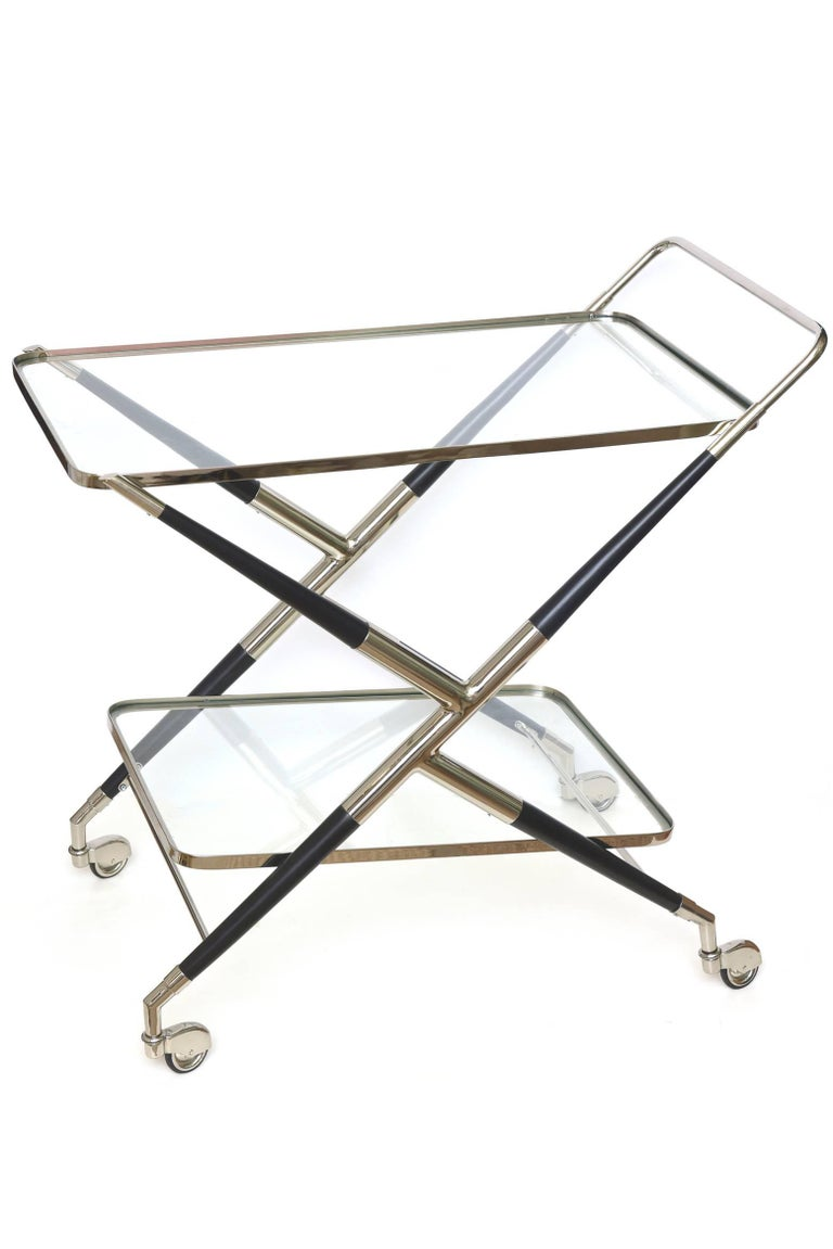 This Mid-Century Modern newly restored Cesare Lacca X-frame two-tiered bar cart is Italian and hallmarked made in Italy Mod Dept Cesare Lacca. The original wheels that also have been nickeled silver are very chic. This entire bar cart has been