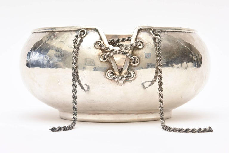 This very special timeless and hallmarked Italian hand forged sterling silver corset and lace up chain bowl has the great influence of fashion. The lace up chain of a corset is quite the conversation piece. This is a very special sterling unusual