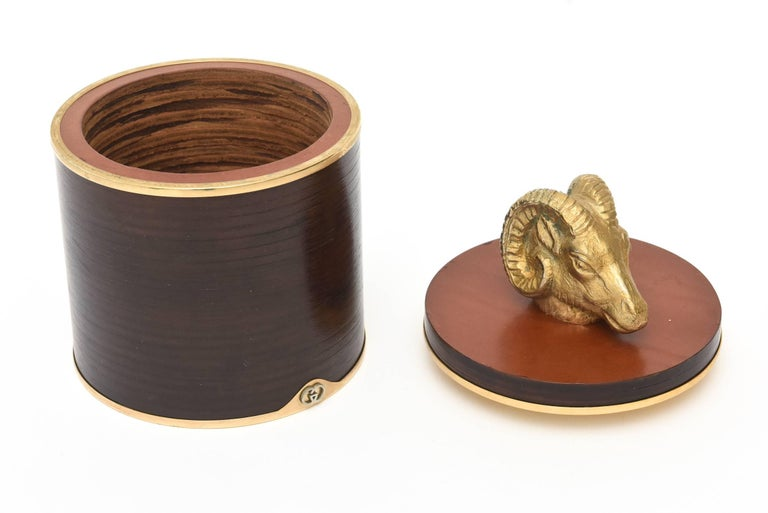 This fabulous Italian vintage hallmarked Gucci two part round rams head box and or humidor is a great combination of leather, wood, cork and brass. It would be a great desk accessory, library or cocktail table box. It is in restored condition.