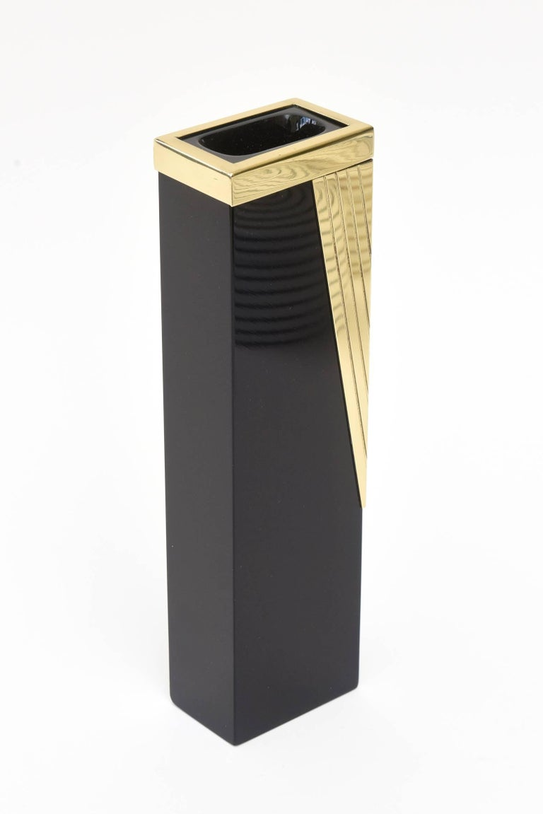 This stunning Italian Murano black glass and polished brass draped accent vase/ bud vase is vintage and has the original label on it made in Italy. That label is at the bottom. It has the feel of art deco meets modern. The brass rimmed top and