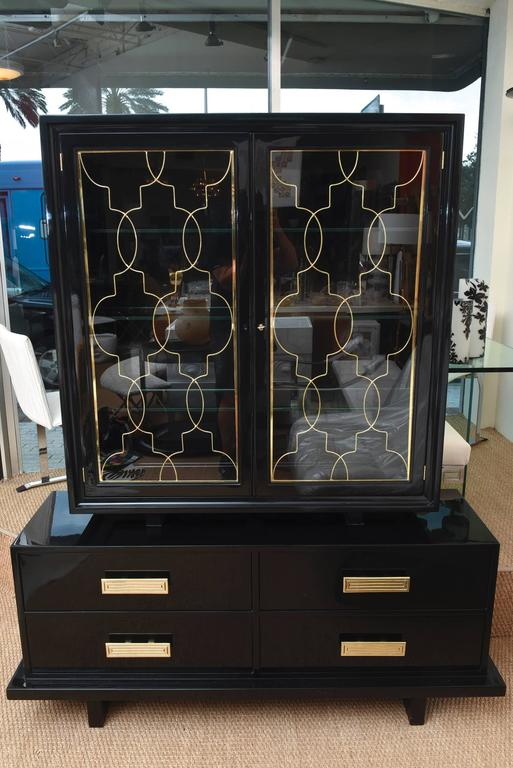 This amazing and rare fully restored and glorified two part cabinet, buffet, console is beautiful. It is by Grosfeld House and rarely seen. It is from the 1940s and is Hollywood Regency yet modern and remains so very elegant. All of the brass