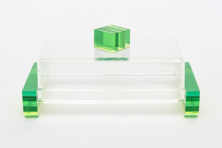 Luscious colors of chartreuse meet green in this arresting and fun box. It is in the style of Charles Hollis Jones. The top square when looked at different angles has black lines in between the chartreuse. The clear licit of the center mixed with