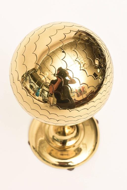 This mid century modern desk accessory or cocktail table sculpture is a solid brass polished globe like object with scalloped designs on the top. This is very well made from the time period and has good weight to it.  NOTE: THIS WILL BE ON SALE FOR