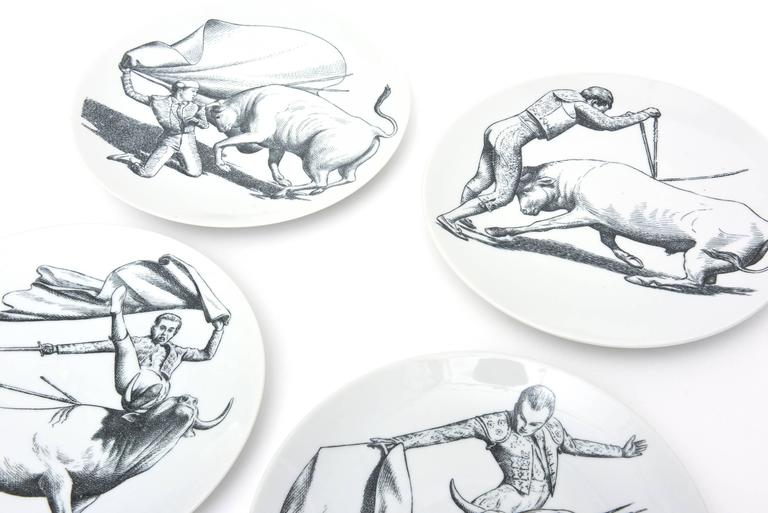 These wonderful hard to find and hard to come by complete set of rare wonderful bullfight black and white vintage Mid-Century Modern porcelain dinner plates are the genius work and imagination of Italian designer, master and artist: Piero