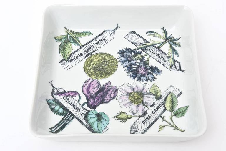 This wonderful substantial sized porcelain square vintage Mid-Century Modern Italian Piero Fornasetti bowl or serving piece has all the elements of botanicals flowers and is entitled