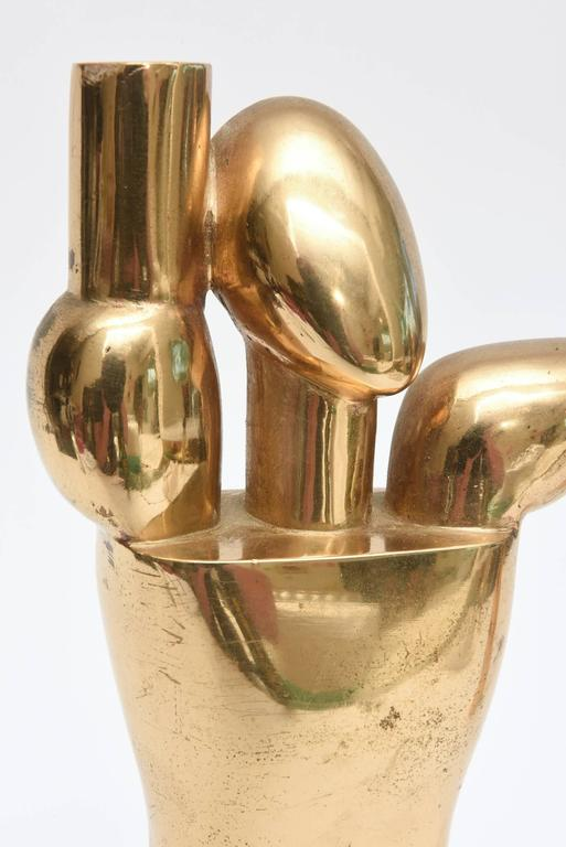 These amazing heavy modernist sculptures are signed by Hugo Rabaey in monogram.