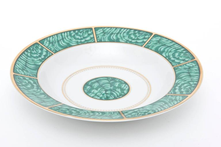 The beautiful design of malachite rings with gold and white in this very imperial looking porcelain china service for four made by Georges Briard vintage from the 1960s. It consists of a dinner plate, salad or desert plate, soup or salad bowl and