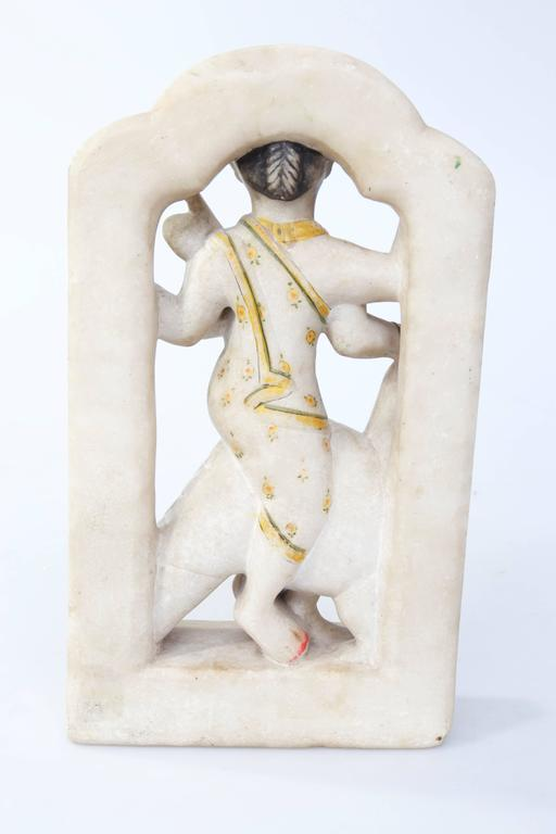 Indian parcel-gilt alabaster sculpture of Indian deity with bird, circa 1800 or earlier.