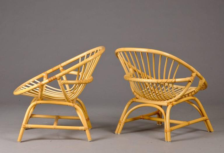 Pair of Danish Rattan hoop form Rattan armchairs. Early 1960s.
