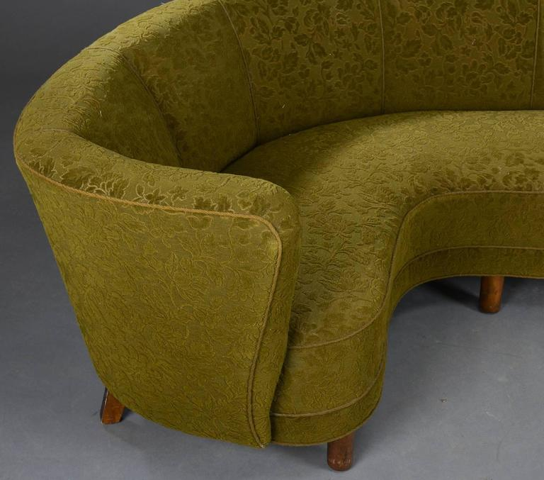 A very comfortable Danish modern green upholstered corner sofa from 1940s. Also very well built and sturdy, with beech legs. The upholstery is original.