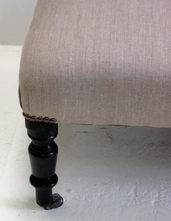19th century French Napoleon III upholstered foot stool on casters. Recently reupholstered in beige linen.