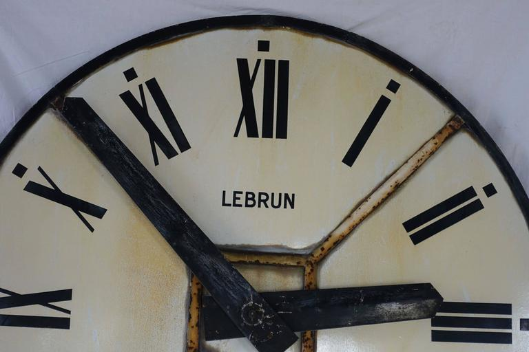 Extra large French clock face with Roman numerals.