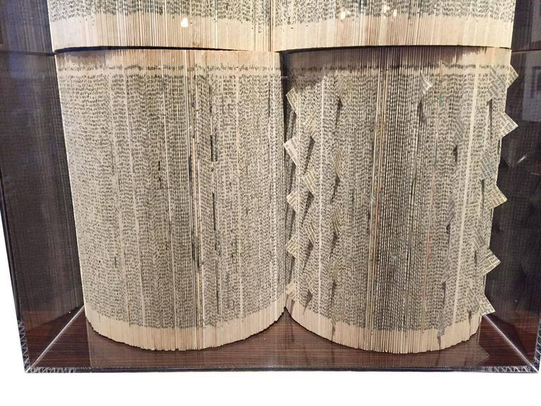 Italian handmade wall art sculpture made of vintage books. Each page is hand folded to make an intricate design. A set of four books in a plexi frame completes the sculpture. The books are dated 1964 and are Storia della Letteratura Italiana