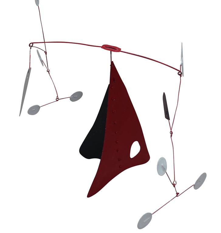 Mid-Century French red / black and white metal mobile in the style of Caldor. Rivet details along base. Two pieces. Arriving August.