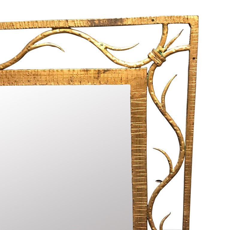 19th century French gold gilt metal mirror with scroll design inserted between the inner and outer frame.