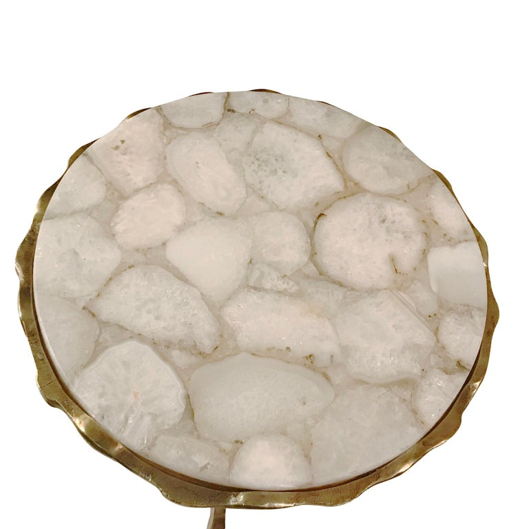 Contemporary Belgian round cocktail table with top of polished pieced or sliced white agate. Tripod hammered bronze legs.