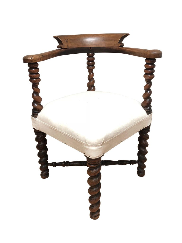19th century English charming spool leg corner chair with decorative cross stretcher.